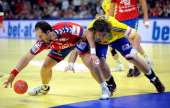 Serbian Alem Toskic fights for the ball with Swedish Andreas Nilsson during the Men's EHF Euro 2012 Handball Championship match Serbia vs Sweden on...