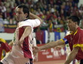 Serbian Alem Toskic shoots to score in front of Spanish team captain Mateo Garralda during their second round match of the World Handball...