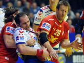 Serbian Alem Toskic vies with Danish Thomas M Mogensen and Kasper Nilsenduring during their Men's EHF Euro 2012 Handball Championship match Serbia vs...
