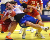 Serbian Alem Toskic vies with Danish Thomas M Mogensen during the 10th Men's EHF Euro 2012 Handball Championship match Serbia vs Denmark on January...