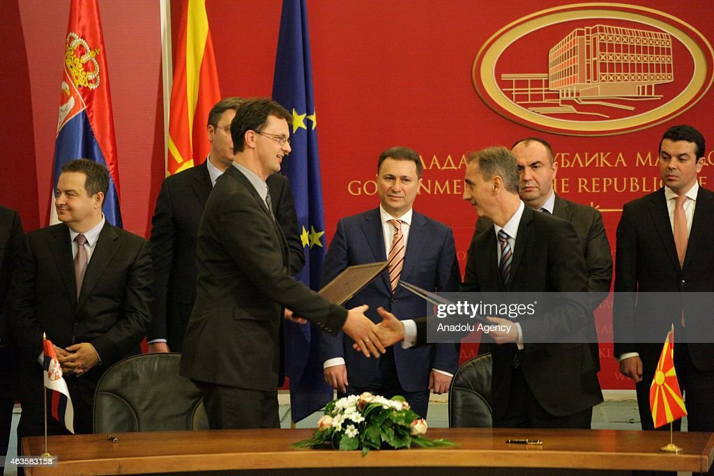Serbian bureaucrats and Macedonian bureaucrats shake hands after they sign a cooperation agreement between their countries in front of their Prime Ministers at the government building in Skopje, Macedonia on 16 February 2015. Alaksandar Vucic and his government arrived for an official visit to Macedonia to attend a joint session of both governments.