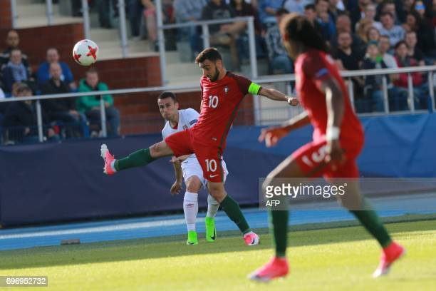 Serbian defender Milan Gajic and Portugal's midfielder Bruno Fernandes vie for the ball during the UEFA U21 European Championship Group B football...