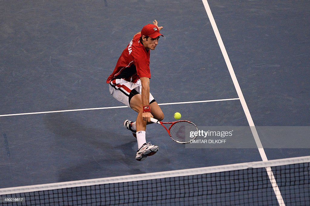 Serbian Dusan Lajovic returns the ball to Czech Radek Stepanek during the Davis Cup final between Serbia and the Czech Republic at the Kombank Arena in Belgrade on November 17, 2013. AFP PHOTO / DIMITAR DILKOFF