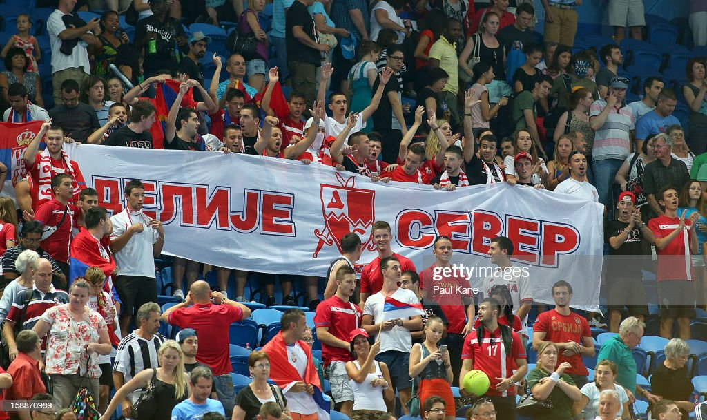 Serbian fans show their support in the mixed doubles match between Novak Djokovic and Ana Ivanovic of Serbia and Bernard Tomic and Ashleigh Barty of Australia during day five of the Hopman Cup at Perth Arena on January 2, 2013 in Perth, Australia.