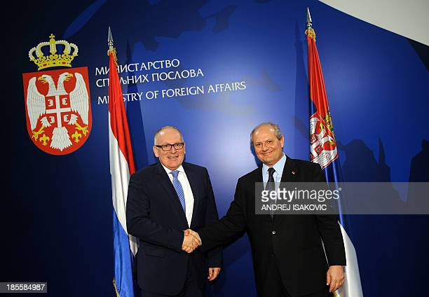 Serbian Foreign Affairs minister Ivan Mrkic shakes hands with his Dutch counterpart Frans Timmermans prior their meeting in Belgrade on October 22...
