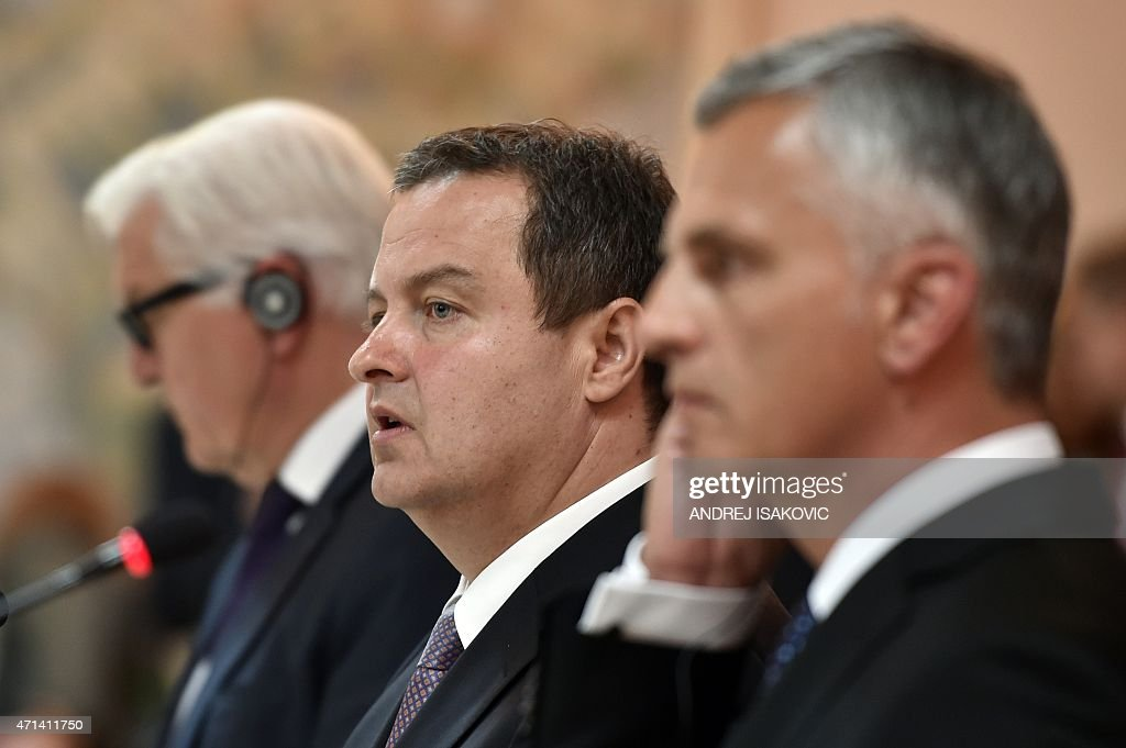 Serbian Foreign Minister and OSCE Chairperson <a gi-track='captionPersonalityLinkClicked' href=/galleries/search?phrase=Ivica+Dacic&family=editorial&specificpeople=5427949 ng-click='$event.stopPropagation()'>Ivica Dacic</a> (C) speaks during a joint press conference with his German counterpart and Swiss counterparts after their meeting in Belgrade on April 28, 2015. AFP PHOTO / ANDREJ ISAKOVIC