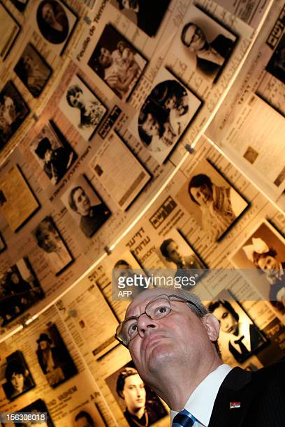 Serbian Foreign Minister Ivan Mrkic looks at pictures of Jewish Holocaust victims at the Hall of Names on November 13 during his visit to the Yad...