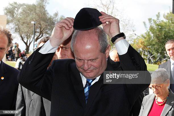 Serbian Foreign Minister Ivan Mrkic wears a kippa the traditional Jewish skullcap for men on November 13 during his visit to the Yad Vashem Holocaust...