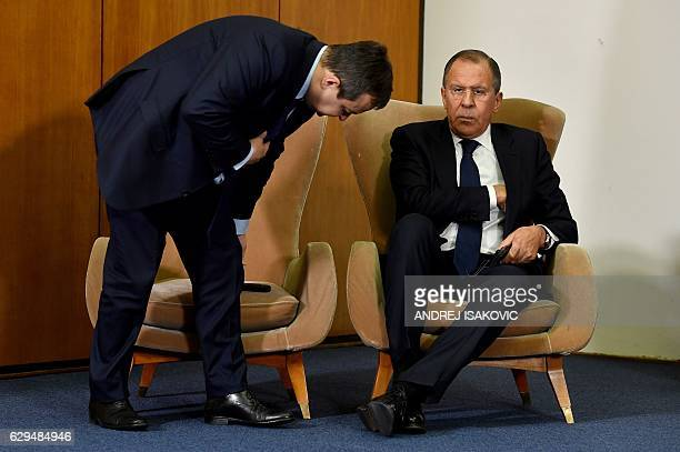Serbian Foreign Minister Ivica Dacic takes his seat next to Russian Foreign Minister Sergey Lavrov during a press conference after the BSEC session...