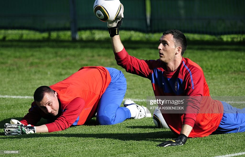 Serbian goalkeepers, Zeljko Brkic (R) in action as Bojan Isailovic looks at him in the local stadium of Leogang, Austria on May 25, 2010 during the first training session of the Serbian team in their training camp to prepare for the 2010 World Cup in South Africa.