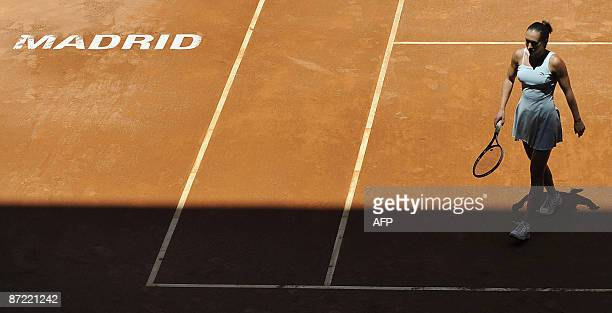 Serbian Jelena Jankovic prepares to serve to Russian Elena Vesnina during their match at the WTA Madrid Open Masters claycourt tournament on May 14...
