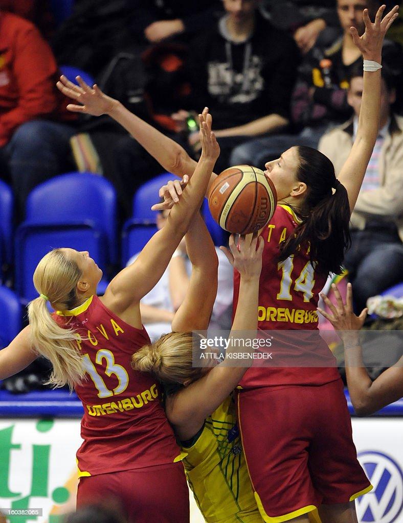 Serbian Jelena Milovanovic (C) of Hungarian UE Sopron fights for the ball between Liudmila Sapova (L) and Tamane Zane (R) of Russian Nadezhda Orenburg on January 30, 2013 during their basketball EuroLeague match in Sopron, Hungary.