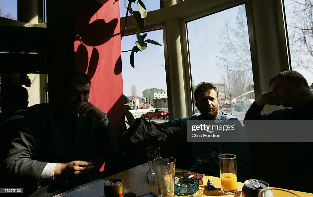 Serbian men sit in the Dolce Vita cafe March 14, 2007 in Mitrovica, Kosovo. Before 1999 Mitrovica was a town where Serbs and ethnic Albanians lived side-by-side. It is now is Kosovo's most glaring symbol of separation, as the two populations quickly separated themselves after the fall of the Serbian government in Kosovo and occupied opposite banks of the Ibar river.