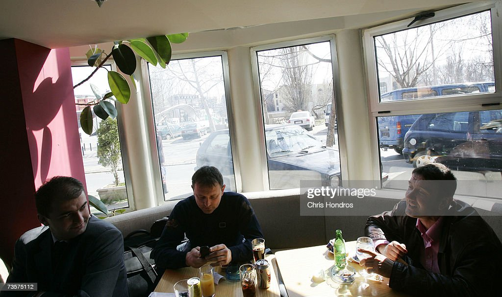 Serbian men sit in the Dolce Vita cafe with sight of the bridge that separates them from Albanians March 14, 2007 in Mitrovica, Kosovo. Before 1999 Mitrovica was a town where Serbs and ethnic Albanians lived side-by-side. It is now is Kosovo's most glaring symbol of separation, as the two populations quickly separated themselves after the fall of the Serbian government in Kosovo and occupied opposite banks of the Ibar river.