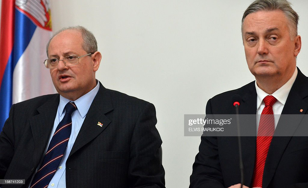 Serbian Minister of Foreign Affairs, Ivan Mrkic (L) and his Bosnian counterpart, Zlatko Lagimdzija (R), take questions at press conference after bi-lateral meeting in Sarajevo on December 27, 2012. Minister Mrkic arrived on a one-day official visit.