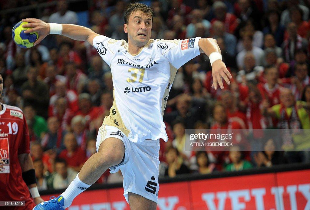 Serbian Momir Ilic of German THW Kiel jumps to shoot against Hungarian MKB Veszprem on October 18, 2012 in Veszprem during their EHF Champions League match.