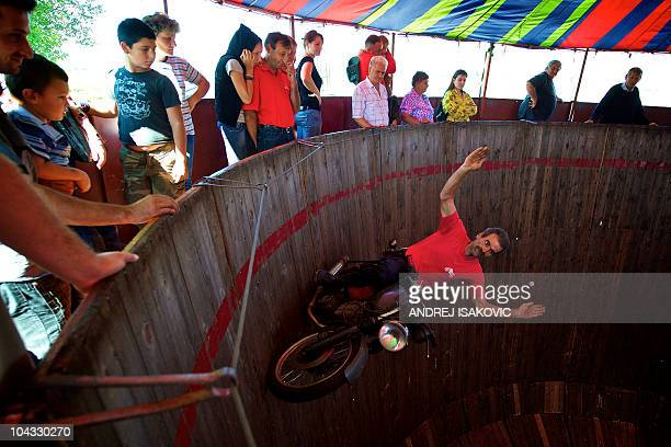 Serbian motorcyclist rides inside of the 'Wall of Death' during a public fair in Sabac 100km west of capital Belgrade on September 21 2010 The Wall...