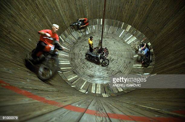 Serbian motorcyclists ride inside of the 'Wall of Death' during a public fair in Sabac some 100 kms west of the capital Belgrade on September 20 2009...