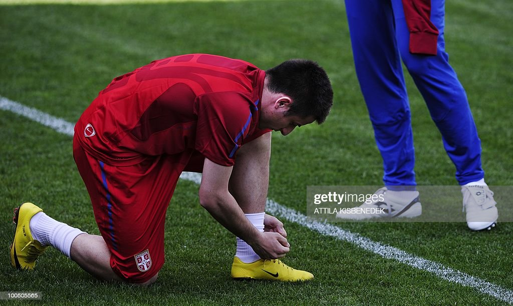 Serbian Nemanja Tomic adjusts his boot in the local stadium of Leogang, Austria on May 25, 2010 prior to the first training session of the Serbian team in their training camp to prepare for the 2010 World Cup in South Africa.