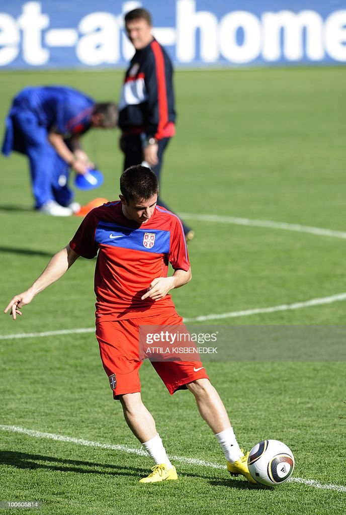 Serbian Nemanja Tomic passes the ball in the local stadium of Leogang, Austria on May 25, 2010 during the first training session of the Serbian team in their training camp to prepare for the 2010 World Cup in South Africa.