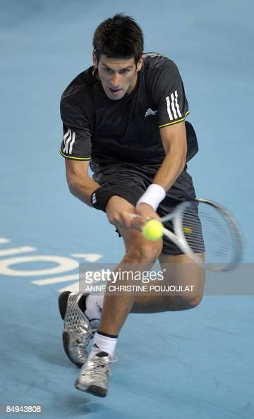 Serbian Novak Djokovic hits a backhand to German Mischa Zverev during their ATP Open 13 tennis tournament quarter final match on February 20 in...
