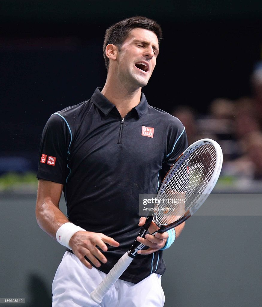 Serbian Novak Djokovic reacts during the men's single semi final match against Swiss Roger Federer at the BNP Paris Masters tennis tournament at Bercy Arena on November 2, 2013 in Paris, France.