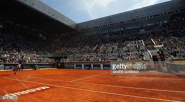 Serbian Novak Djokovic returns the ball against Spanish Rafael Nadal during their semi final match of the ATP Madrid Open claycourt tournament...