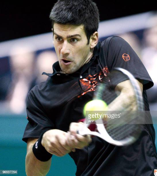 Serbian Novak Djokovic returns the ball in his match against Sergiy Stakhovsky from Ukraine during the ABN AMRO World Tennis Tournament in Rotterdam...