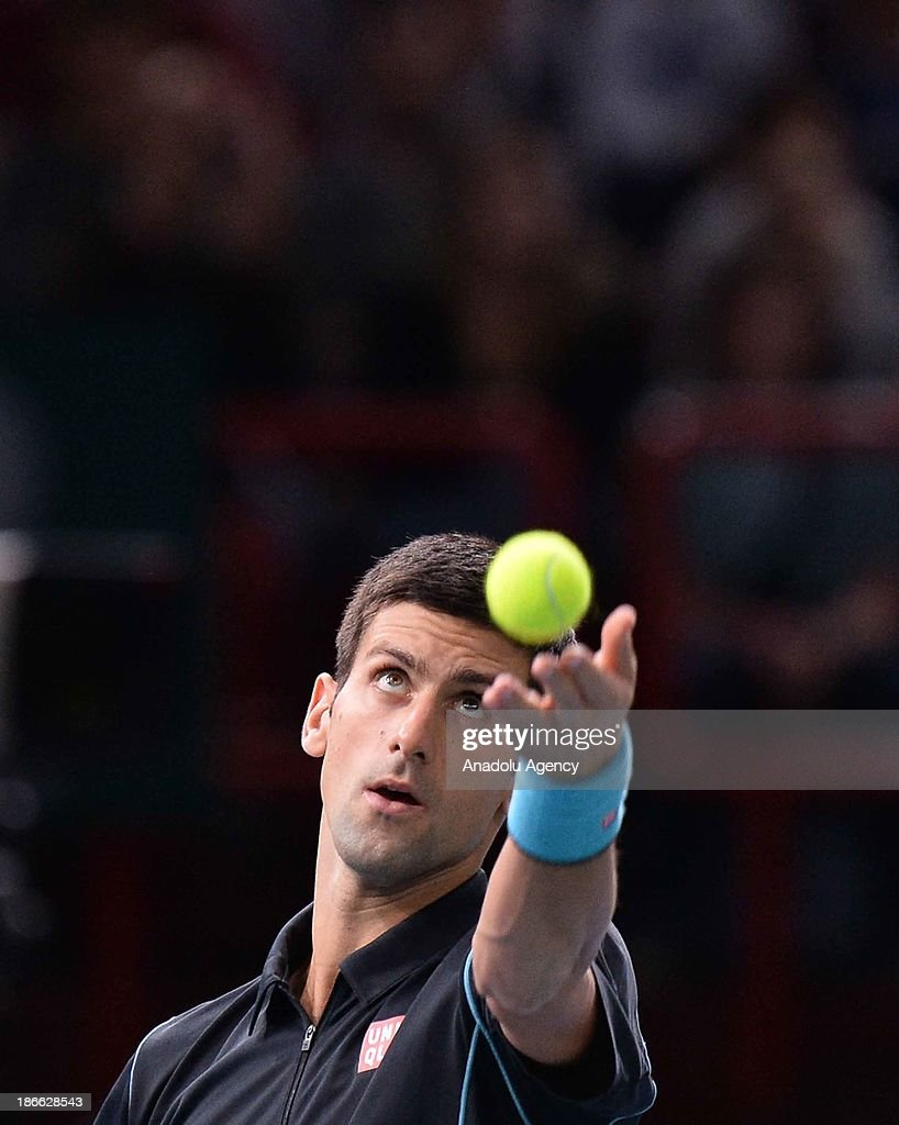 Serbian Novak Djokovic serves the ball to Swiss Roger Federer during the men's single semi final match at the BNP Paris Masters tennis tournament at Bercy Arena on November 2, 2013 in Paris, France.