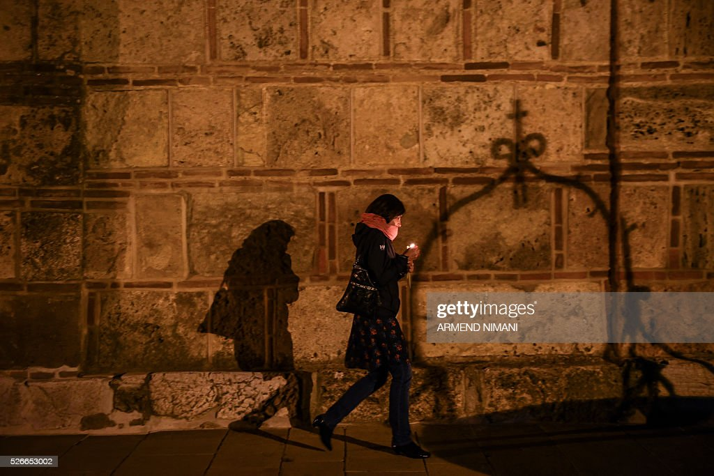 A Serbian Orthodox believer walk with a candle during Orthodox Easter religious services in the Medieval Monastery in the town of Gracanica on April 30, 2016. Orthodox Christian believers mark the Holy Week of Easter in celebration of the crucifixion and resurrection of Jesus Christ. / AFP / ARMEND