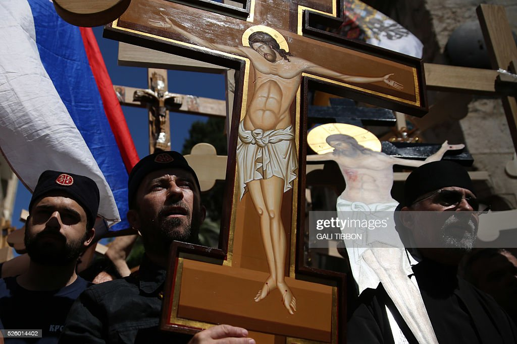 Serbian Orthodox Christian pilgrims carry wooden crosses along the Via Dolorosa (Way of Suffering), during the Good Friday procession in Jerusalem's old city on April 29, 2016. Thousands of pilgrims took part in processions along the route where, according to tradition, Jesus carried the cross during his last days. / AFP / GALI