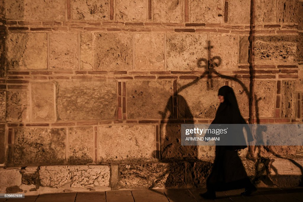 A Serbian Orthodox nun walks during the Orthodox Easter religious services in the Medieval Monastery in the town of Gracanica on April 30, 2016. Orthodox Christian believers mark the Holy Week of Easter in celebration of the crucifixion and resurrection of Jesus Christ. / AFP / ARMEND