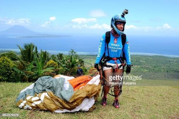 Serbian paraglider Tamara Kostic prepares during the Paragliding Accuracy World Cup 1st Series 2017 at Mount Tumpa on March 17 2017 in Manado...