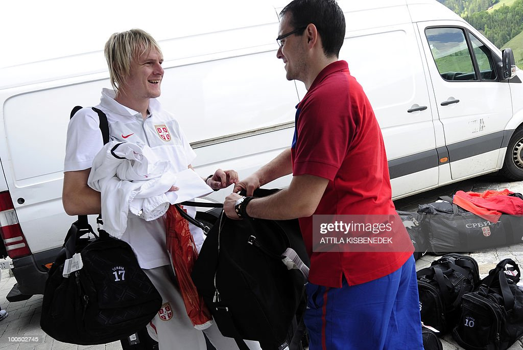 Serbian player Milos Krasic (L) of CSKA Moscow shares a light moment with an unidentified staff as their national soccer team arrives at the Hotel Krallerhof in Leogang, Austria on May 25, 2010 where the Serbian team is staying while holding a training camp to prepare for the 2010 World Cup in South Africa.