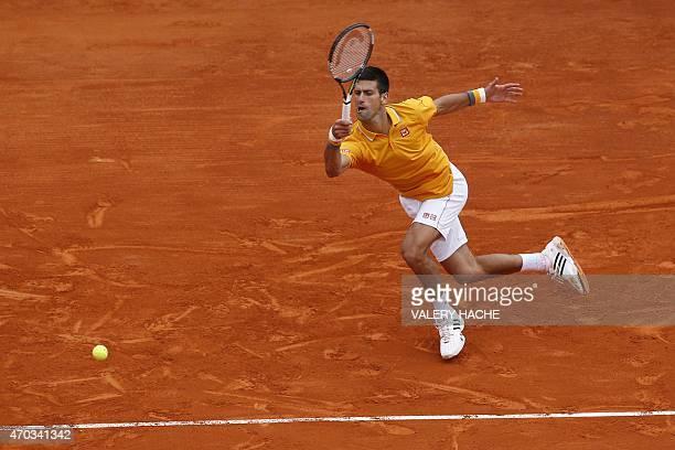 Serbian player Novak Djokovic hits a return to Czech Republic's Tomas Berdych during the MonteCarlo ATP Masters Series Tournament final tennis match...