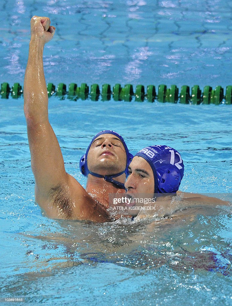 Serbian players captain Vanja Udovicic and Stefan Mitrovic celebrate their victory against Montenegro in the Mladost venue swimming pool of Zagreb on...