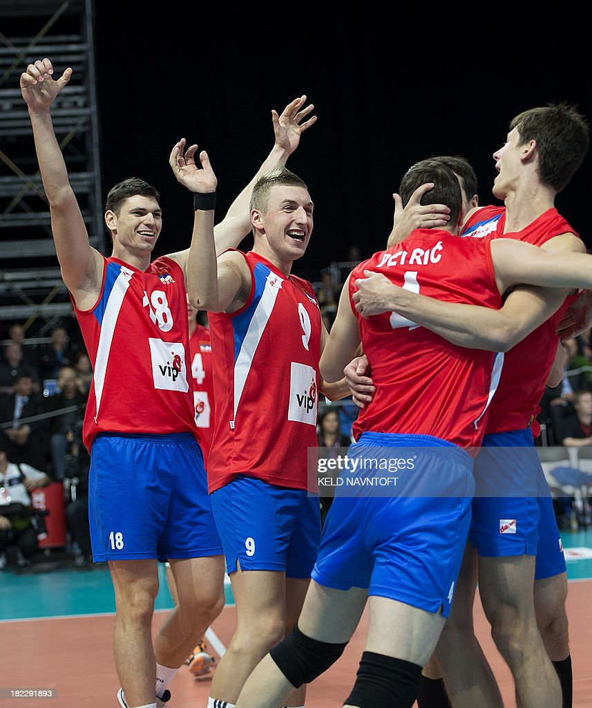 Serbian players Serbian players Marko Podrascanin Nikola Jovovic and Nemanja Radovic cheer after their victory during the bronze medal match between...