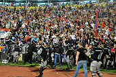 Serbian police secure supporters of Serbian national soccer players during brawl between players on the pitch during the UEFA EURO 2016 group I...