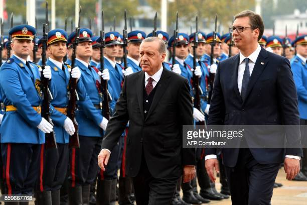 Serbian President Aleksandar Vucic and his Turkish counterpart Recep Tayyip Erdogan review a guard of honor prior to their meeting in Belgrade on...