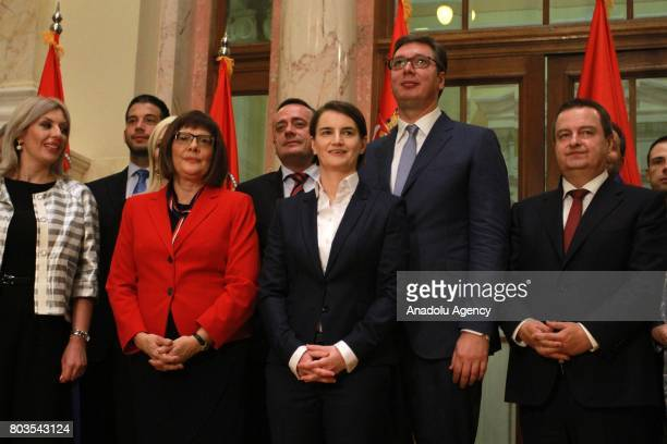 Serbian President Aleksandar Vucic and Serbian Prime Minister Ana Brnabic stand with Mp's after Ana Brnabic received vote of confidence at the...