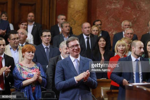 Serbian President Aleksandar Vucic applauds after Serbian Prime Minister Ana Brnabic received vote of confidence at the National Assembly in Belgrade...