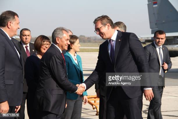 Serbian President Aleksandar Vucic shakes hands with Russian Defence Minister Sergei Shoigu during a ceremony to mark the 73 anniversary of...