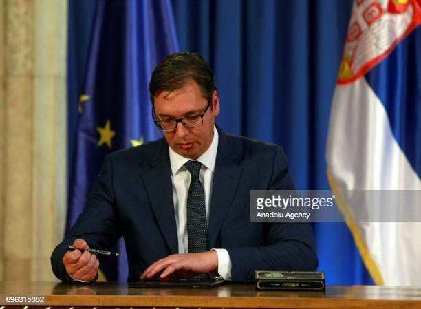Serbian President Aleksandar Vucic signs during a press conference in Belgrade Serbia on June 15 2017 Vucic announced Serbian Minister of Public...
