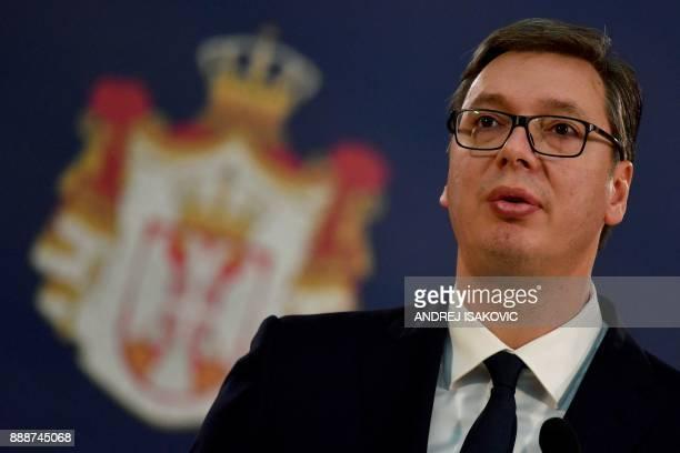 Serbian President Aleksandar Vucic speaks during a joint press conference after their meeting in Belgrade on December 9 2017 / AFP PHOTO / ANDREJ...