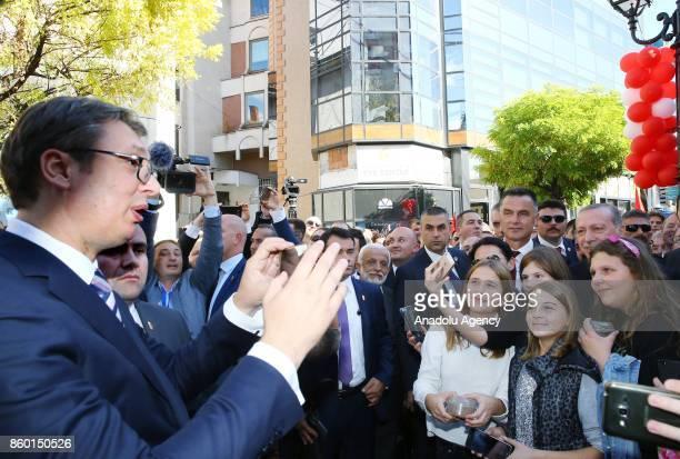 Serbian President Aleksandar Vucic takes photo of Turkish President Recep Tayyip Erdogan with citizens during their visit in Novi Pazar Serbia on...