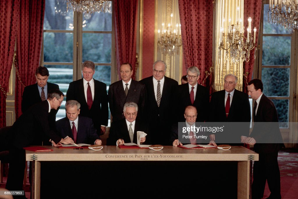 Serbian President <a gi-track='captionPersonalityLinkClicked' href=/galleries/search?phrase=Slobodan+Milosevic&family=editorial&specificpeople=206908 ng-click='$event.stopPropagation()'>Slobodan Milosevic</a>, Croat President <a gi-track='captionPersonalityLinkClicked' href=/galleries/search?phrase=Franjo+Tudjman&family=editorial&specificpeople=226623 ng-click='$event.stopPropagation()'>Franjo Tudjman</a>, and Bosnian President <a gi-track='captionPersonalityLinkClicked' href=/galleries/search?phrase=Alija+Izetbegovic&family=editorial&specificpeople=226711 ng-click='$event.stopPropagation()'>Alija Izetbegovic</a> sign multiple copies of the Dayton Peace Agreement in the Palais de l'Elysee. Six other world leaders look on as witnesses to the historical agreement which was intended to end the bloodshed and vicious fighting which began after the fall of Communism in 1989-1990 in the republics of the former Yugoslavia.