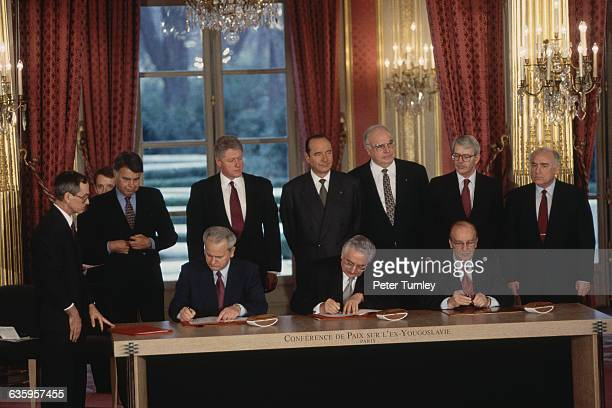 Serbian President Slobodan Milosevic Croat President Franjo Tudjman and Bosnian President Alija Izetbegovic sign multiple copies of the Dayton Peace...