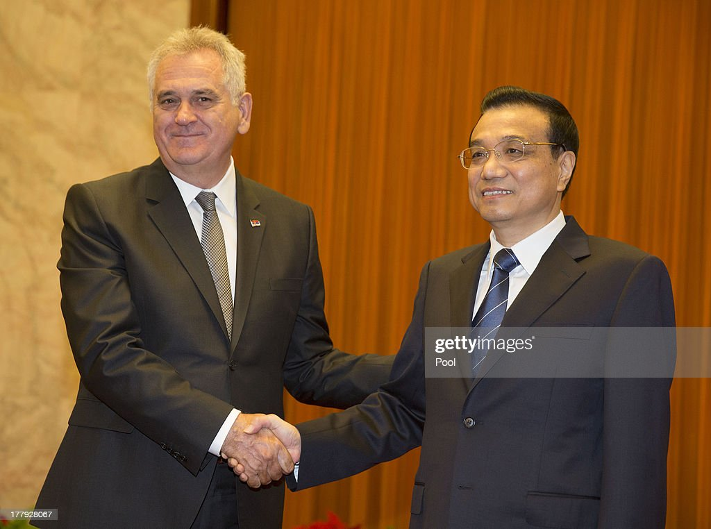 Serbian President Tomislav Nicolic (L) and Chinese Premier <a gi-track='captionPersonalityLinkClicked' href=/galleries/search?phrase=Li+Keqiang&family=editorial&specificpeople=2481781 ng-click='$event.stopPropagation()'>Li Keqiang</a> meet for talks at the Great Hall of the People on August 26, 2013 in Beijing, China. Nicolic is on a five day visit to China to bolster economic and diplomatic ties.