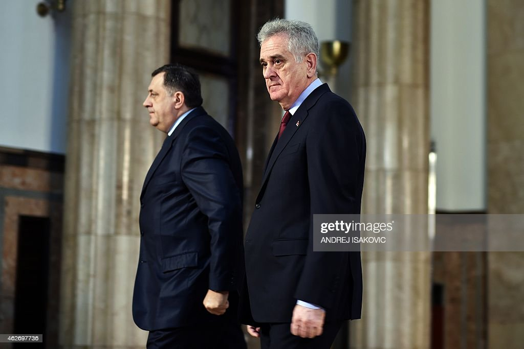 Serbian President Tomislav Nikolic (R) flanked by Bosnian Serb political leader, Milorad Dodik, leaves a joint press conference on February 3, 2015, in Belgrade, after the UN's highest court on rejected rival claims of genocide by Croatia and Serbia.The IJC dismissed Croatia's claim that Serb forces committed genocide during the country's 1991-1995 war of independence and issued a similar ruling on a counter-claim by Belgrade over a Croatian counter-offensive that forced 200,000 Serbs to flee. AFP PHOTO / ANDREJ ISAKOVIC