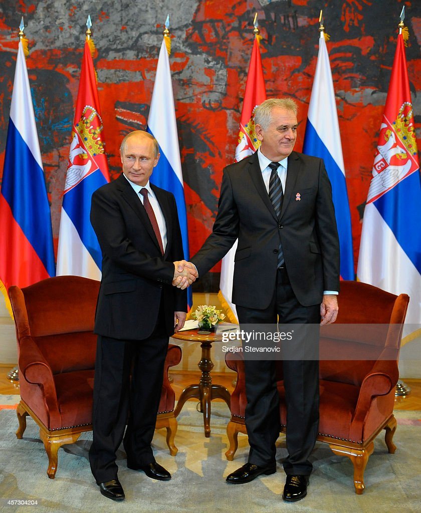 Serbian President <a gi-track='captionPersonalityLinkClicked' href=/galleries/search?phrase=Tomislav+Nikolic&family=editorial&specificpeople=801987 ng-click='$event.stopPropagation()'>Tomislav Nikolic</a> (R) shakes hands with his Russian counterpart <a gi-track='captionPersonalityLinkClicked' href=/galleries/search?phrase=Vladimir+Putin&family=editorial&specificpeople=154896 ng-click='$event.stopPropagation()'>Vladimir Putin</a> on October 16, 2014 in Belgrade, Serbia. Putin is on a one day vistit to Belgrade.